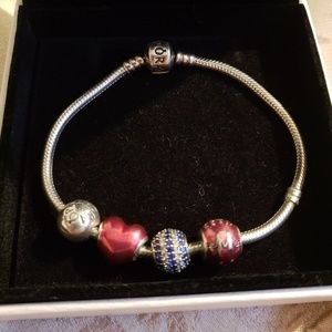 Pandora Bracelet with 3 charms and 1 clip